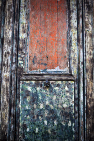 restoring: Old wooden and painted door before restoring