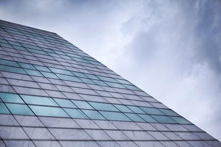 buiding: Glass wall of a buiding facade and cloudy sky