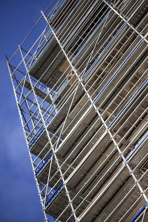 footbridges: Detail of scaffolding and blue sky on a construction site