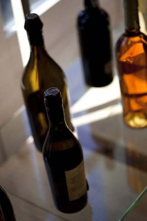 oenology: Various liquor bottles on a glass table in a winery