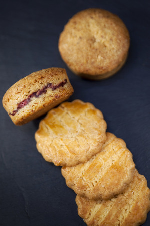 shortbread: Crispy shortbread cookies filled with raspberry cream