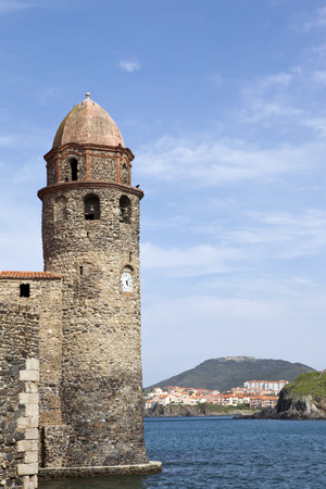 stoned: Old stoned lighthouse of the village of Collioure, South of France Stock Photo