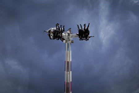 fairground: Close up of teens on a ride at a fairground