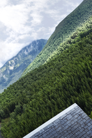 slate roof: Slate roof and mountains in French Pyrenees