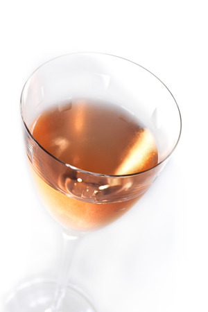 oenology: Close up of rose wine in a crystal glass