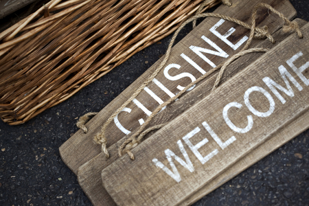 welcom: Welcom and cuisine signs on wooden board in a flea market