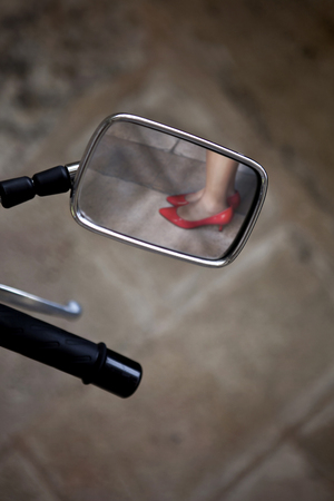 rear view mirror: View in the rear view mirror of motorcycle Stock Photo