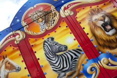 circus caravan: Decoration with animals painted on a circus trailer