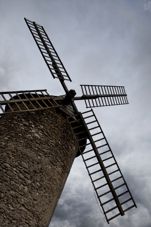 Old mill and cloudy sky in background