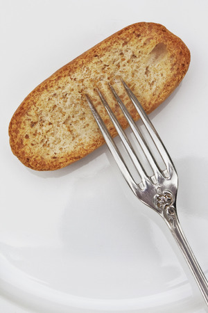 Silver fork and swedish bread roll Reklamní fotografie