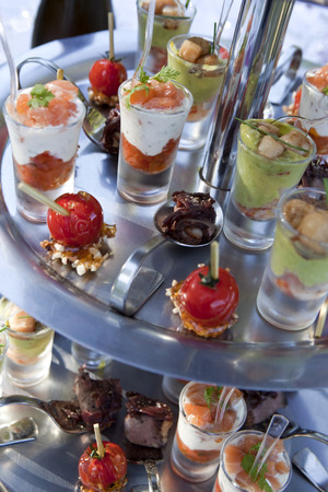 Glasses and appetizers on the buffet of a caterer in a party