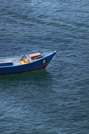 Small fishing boat on the blue sea