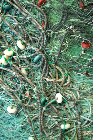 Background of green fishing nets on the port