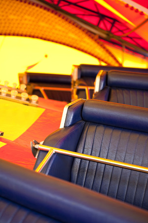 Leatherette seats of a vintage attraction in a fairground