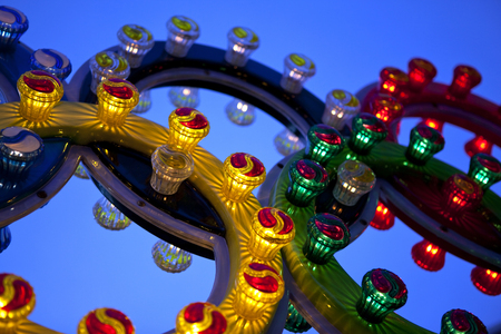 Close up of colorful bulbs on a fairground attraction Stock Photo