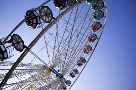 Big wheel and blue sky in a fairground