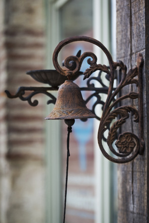 Bronze bell at the door of a house