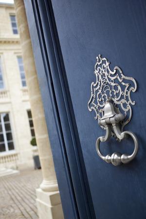 Bronze knocker on a wooden door