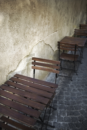 Chairs and tables on the terrace of a bistro