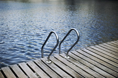 Pool lader and wooden deck on a lake