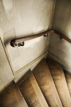 Wooden steps and banister in a weathered French mansion Stock Photo