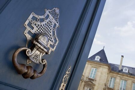 Opening a stylish wooden door of a French mansion
