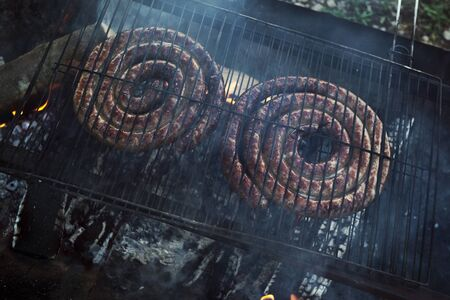 Pork sausage on a grill for a barbecue