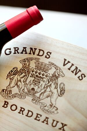 Detail of a wine wooden box and bottle of Bordeaux wine Reklamní fotografie