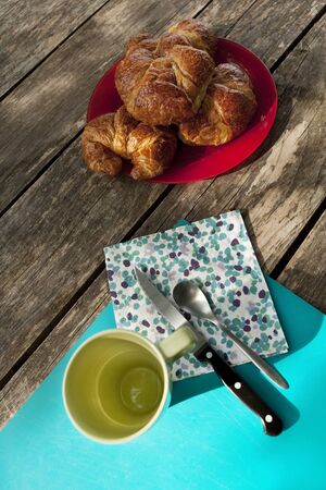 Breakfast for holidays with French croissants on a wooden table Reklamní fotografie