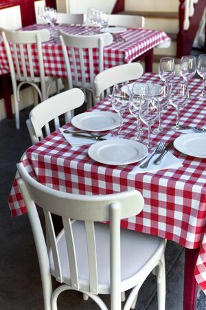 Table set on the terrace of a vintage French bistro