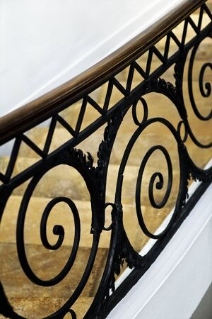 Stylish wrought iron handrail inside a French mansion Stock Photo