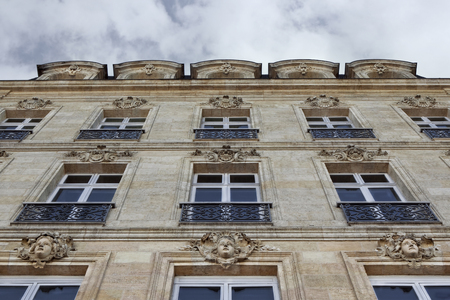 Facade of a French mansion in Bordeaux city Redakční