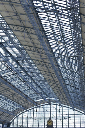Glass roof and clock inside the hall of the Bordeaux railway station in France