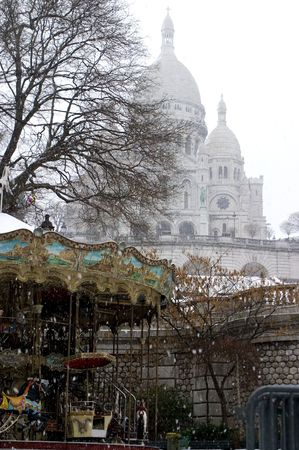 sacre coure with merry go around in snow photo