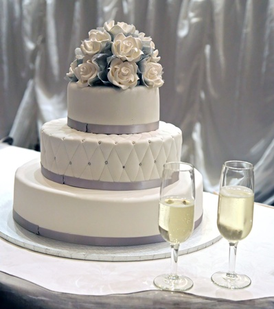 wedding cake: A white wedding cake with white icing roses
