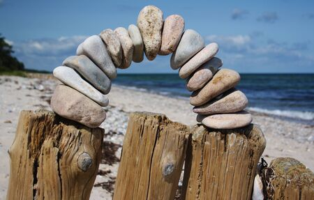 arch of pebbles on beach, Enebaerodde, island Fyn, Denmark