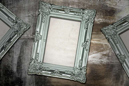 Silver Antique Frames on Weathered Wood Background