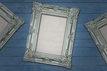 Silver Antique Frames on Weathered Blue Wood Background