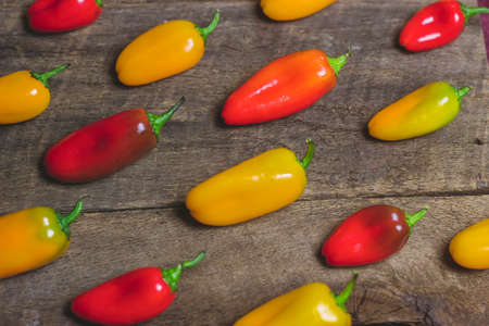 red food: Yellow and Red Vegetable Peppers on Wood Background
