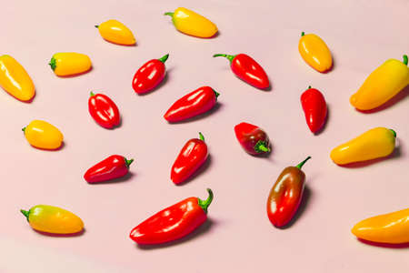 sweet peppers: Yellow and Red Sweet Peppers on Pink Background