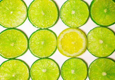 standout: Group of Green Lime Slices with One Standout Lemon Slice