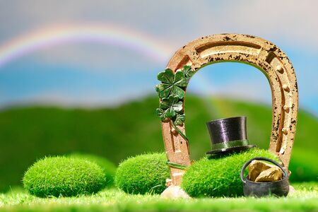 Outdoors Leprechaun Hat in Meadow under a Rainbow for Saint Patrick's Day Celebration