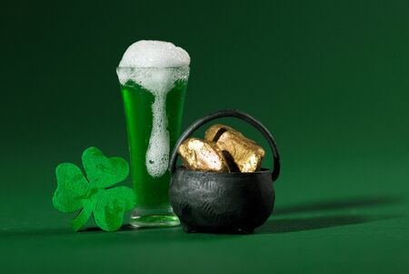 Green Pint of Beer, Shamrock and Pot of Gold on Green Background