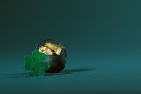 Pot of Gold and Wooden Four-Leaf Clover on Turquoise Background