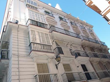 Facade of apartment building in Cadiz ,Spain photo
