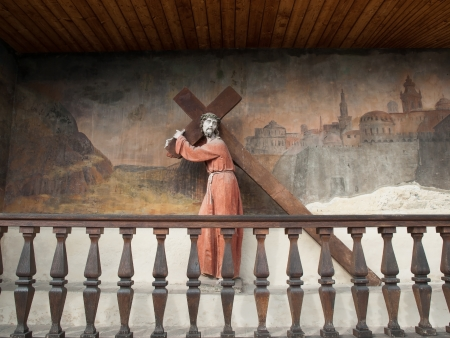 carries: Statue and fresco at base of Piaristen Church in Krem ,Austria