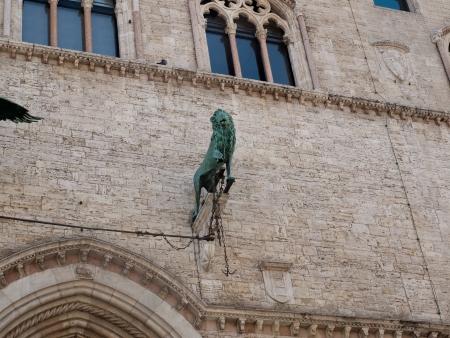 priori: Detail from Palazzo dei Priori-City Hall in Perugia Editorial