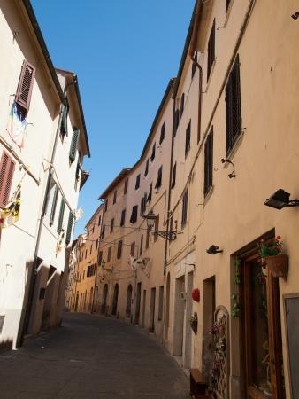massa: The narrow street of Massa Marittima in Italy Stock Photo
