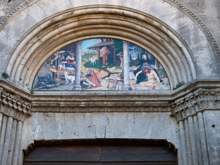massa: The portal of the church St. Augustine in Massa Marittima , Italy Stock Photo