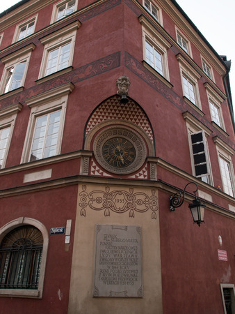 corner clock: Wall-clock in Old Town in Warsaw